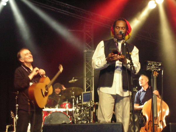 Poet Benjamin Zephaniah on stage with folksinger Martin Carthy on the left (Image courtesy Wikimedia Commons)