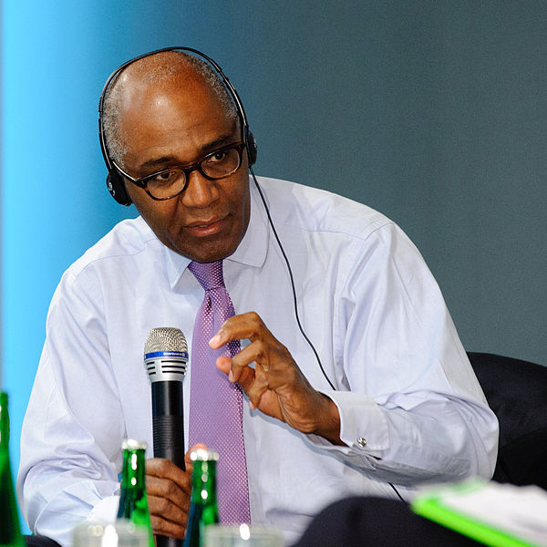 A photograph of Trevor Phillips OBE holding a microphone